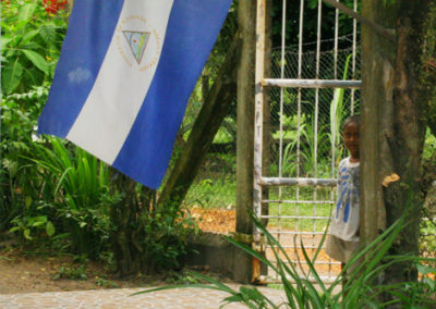 nicaragua-200-Peeking-out-behind-flag
