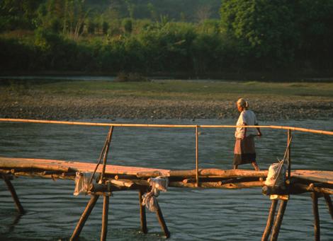 Laos_woman_on_bridge