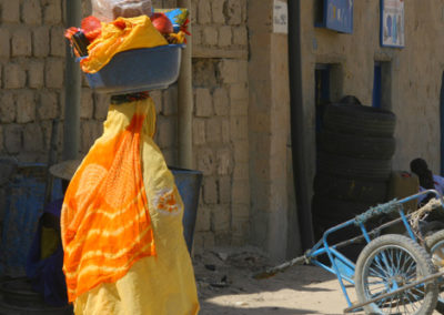 Mali_56_m_woman_carying_on_head