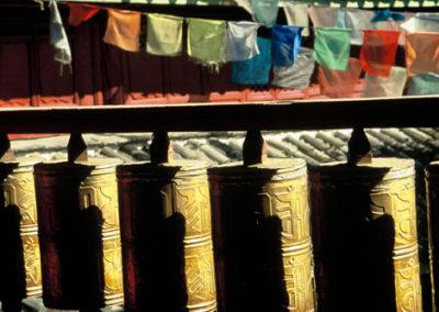Tibet_prayer_flags_and_prayer_wheels
